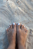 Bare feet girl on white sand Royalty Free Stock Image