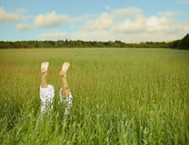 Bare feet from green grass Stock Image
