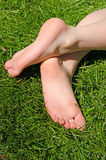 Bare feet in green grass Royalty Free Stock Image