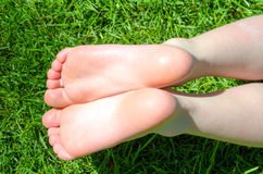 Bare feet in green grass Stock Photo