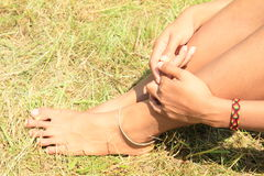 Bare feet and hands on grass Royalty Free Stock Photography