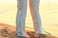 Bare feet kissing couple Stock Photo
