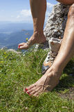 Bare feet and legs with Varicose Veins of tourist hiker Stock Images
