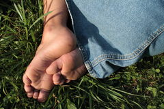 Bare feet of a little girl Stock Photo