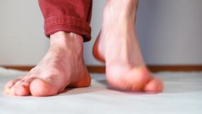 Bare feet of a man.