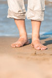 Bare feet in the men's linen trousers Stock Photo