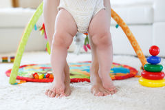 Bare feet mother and child on a white carpet Stock Photos