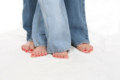 Bare feet with painted Toes and Blue Jeans Royalty Free Stock Images