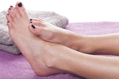 Bare feet with pedicure propped by towel Royalty Free Stock Photography