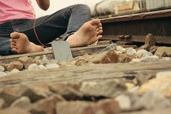 Bare feet on the railway with smartphone Stock Photography