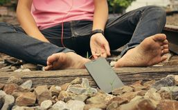 Bare feet on the railway with smartphone Stock Photos