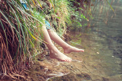 Bare feet of the river. A child enjoying the outdoors. Stock Photography
