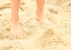 Bare feet on sand. Bare feet of a little girl - child standing on sand Royalty Free Stock Photography
