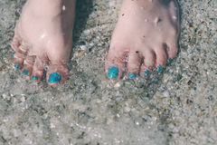 Bare feet on the sand Royalty Free Stock Photo