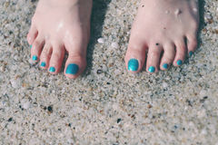 Bare feet on the sand Stock Photography