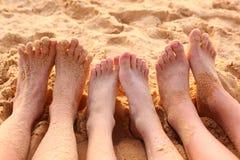 Bare feet on the sandy beach. Close up photo Royalty Free Stock Photos