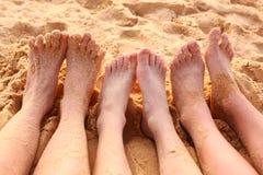 Bare feet on the sandy beach. Close up photo Stock Photography