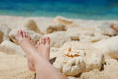 Bare feet in the sea on the shore of the Sea Royalty Free Stock Photography