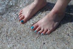 Bare feet in the sea Stock Photos