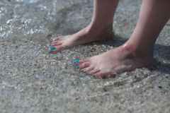 Bare feet in the sea Stock Photo