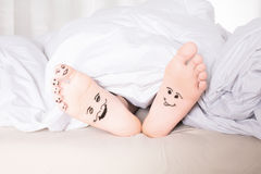 Bare feet with smiley faces Royalty Free Stock Image