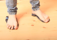 Bare feet on socks. Bare feet a girl - young kid standing on socks on wooden floor Royalty Free Stock Images