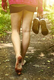 Bare feet walking along forest way close up photo. Bare feet walking along the forest path close up photo Stock Photos