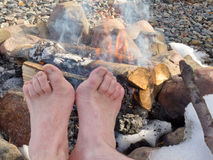 Bare Feet warming at a Campfire Royalty Free Stock Image