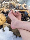 Bare Feet warming at a Campfire in winter Royalty Free Stock Photos