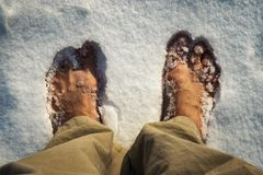 Bare feet in white snow. Seasonal background bare feet in white snow royalty free stock photography