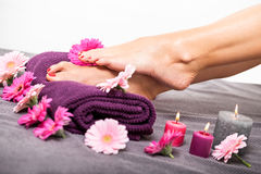 Bare feet of a woman surrounded by flowers Royalty Free Stock Image