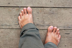 Bare feet on the wooden floor Royalty Free Stock Photo