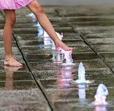 Bare feets in the fountain Royalty Free Stock Photography