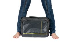 Bare female feet and bag Royalty Free Stock Photography