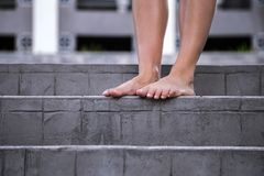 Bare female feet on the stairs Stock Images
