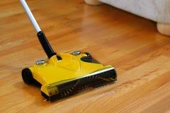 Bare Floor Sweeper. Wood Floor Sweeper on Bare Wooden Floor Stock Photos