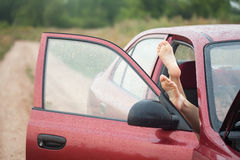 Bare foot from car Royalty Free Stock Image
