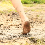 Bare foot of a little girl in mud Stock Photo