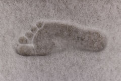 Bare foot print on the snow. royalty free stock photo