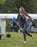 Bare foot racing. MARYSVILLE, VICTORIA, AUSTRALIA - November 2: A young bare foot woman participating in a hobby horse race at the Marysville Sparkling Wine stock images