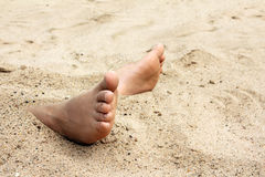 Bare foot in sand. Summer vacations - bare foot in sand Royalty Free Stock Photography