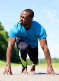 Bare foot sports man stretching exercise workout Royalty Free Stock Image