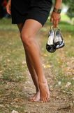 Bare foot woman walk outdoor Royalty Free Stock Image
