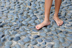 Bare Footed On Cobblestone Stock Images