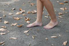 Bare Footed Walking On Tarmac Royalty Free Stock Photography