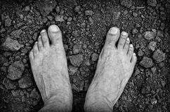 Bare foots over dry soil Stock Photography