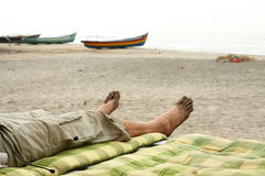 Bare foots relaxing in beach Stock Image