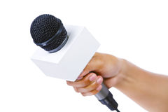 Bare hand holding microphone Stock Photos