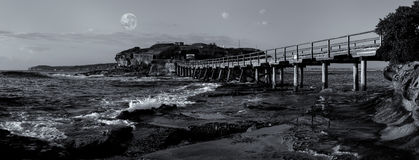 Bare Island bridge with full moon, La Perouse Royalty Free Stock Images