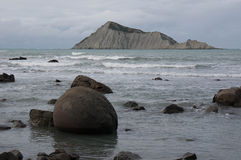 Bare Island (Motu-O-Kura).  Hawke's Bay. New Zealand. View on Bare Island (Motu-O-Kura in maori) from South Waimarama beach in Hawke's Bay, North Island, New Royalty Free Stock Image